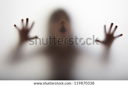 a girl  silhouette behind a  transparent  paper - stock photo
