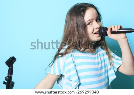 A girl sing in a microphone - stock photo