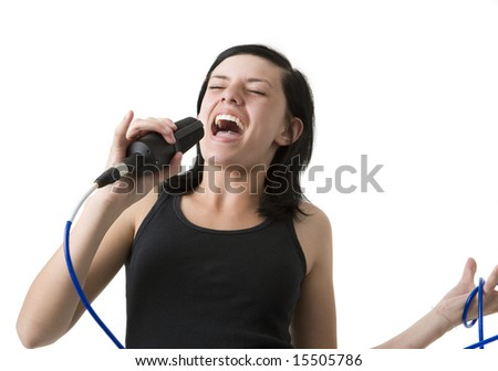 A girl sings loudly into a mic - stock photo