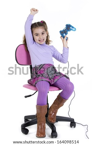a girl sitting, playing a game video games - stock photo