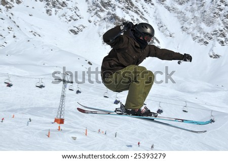 a girl skier during a high jump in a crouched position