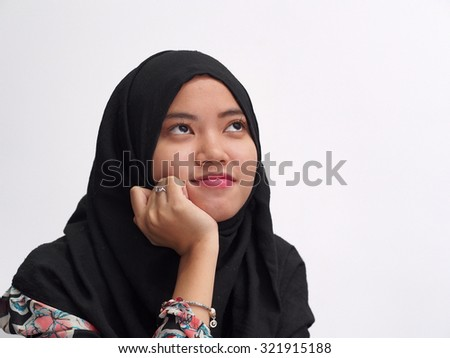 A girl smiling away. - stock photo