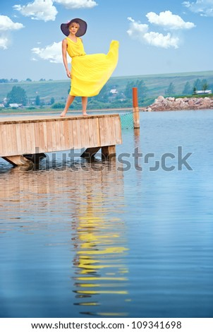 A girl standing on the dock - stock photo