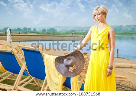 A girl stands at the lounges in the resort - stock photo