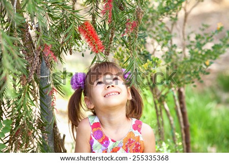 A girl under the tree - stock photo