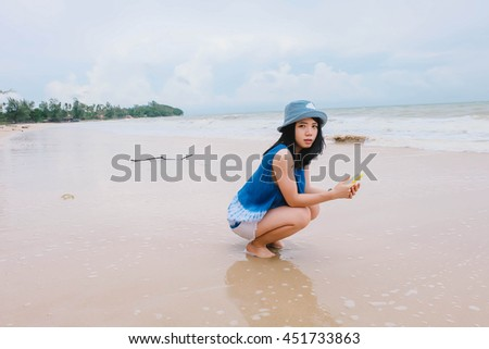 A girl wear indigo dyed cotton cloth on the sea