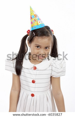 a girl wearing a party hat over a white background