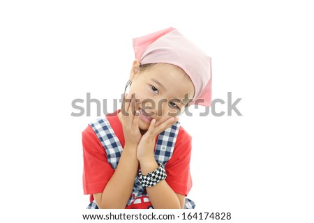 A girl wearing apron - stock photo