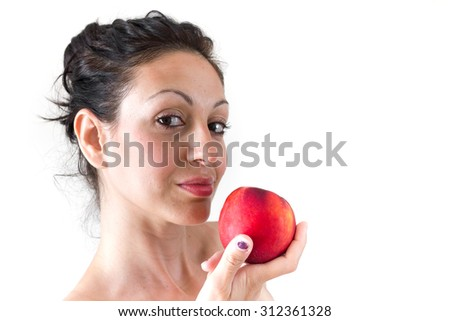 A girl while eating a peach, isolated on white background.