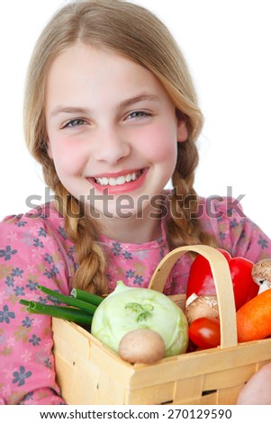a girl with a basket full of vegetables - stock photo