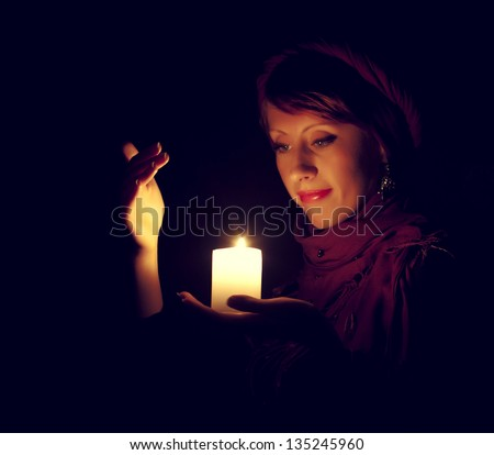 A girl with a candle in his hand