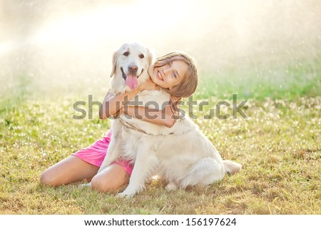A girl with a dog - stock photo