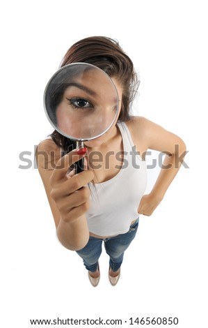 a girl with a magnifying lens - stock photo