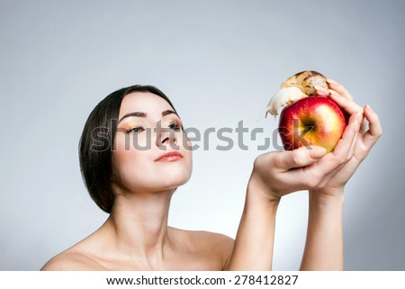 A girl with a snail on the apple