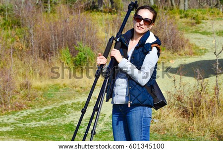 a girl with a tripod taking pictures
