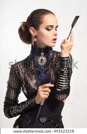 A girl with a whip - stock photo