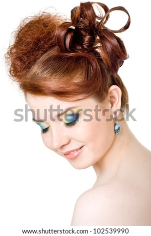 A girl with bright make-up, white background - stock photo