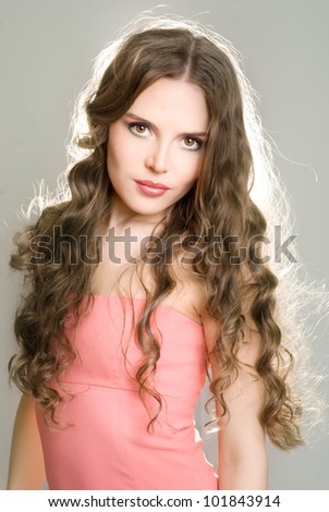 A girl with bright makeup with long hair - stock photo