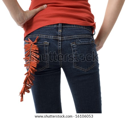 A girl with firecrackers in her back pocket - stock photo