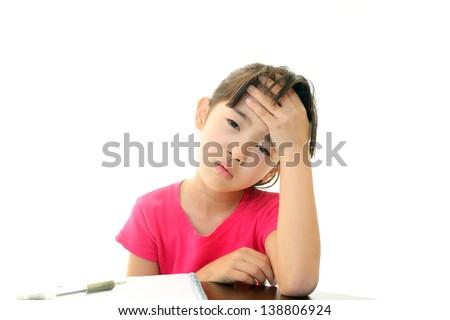 A girl with headache - stock photo
