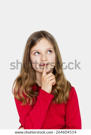 A girl with long hair looks thoughtfully up/thinking girl/decision - stock photo
