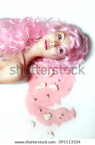 A girl with pink hair and a marshmallow