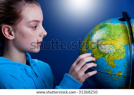 a girl with the globe