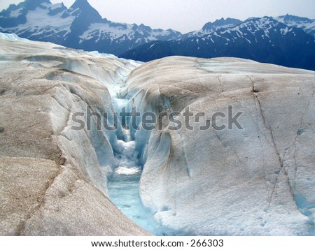 A glacial stream and waterfall on Mendenhall Glacier in Juneau, Alaska, - stock photo
