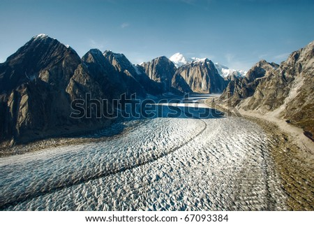 A glacier flows away from Mount McKinley where it originates. - stock photo