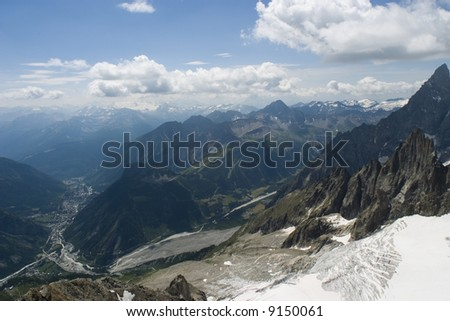 A glacier runs down into the valley in Chamonix, France.