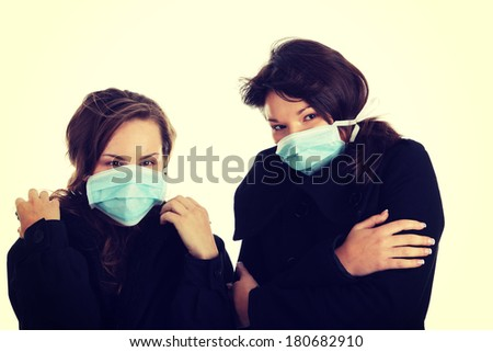 A glamorous model wearing a mask to prevent 'Swine Flu' infection.  - stock photo