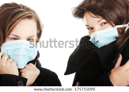 A glamorous models wearing a mask to prevent 'Swine Flu' infection.  - stock photo
