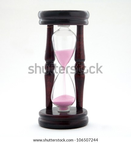 A glass and wooden hourglass isolated on white