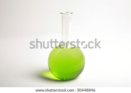 a glass chemistry beaker filled with green liquid - stock photo