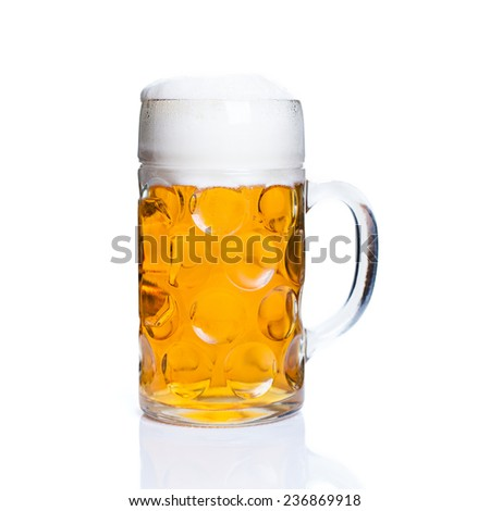 a glass of beer on isolated background - stock photo