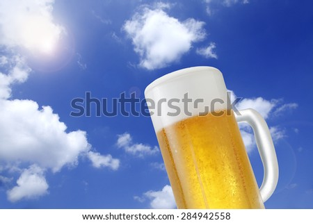 A glass of beer on the background of blue sky