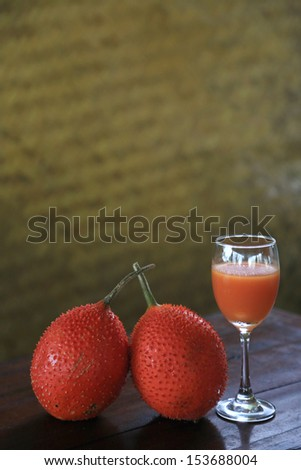 A glass of Bitter Gourd or Sweet Gourd Smoothie. closeup shot with shallow DOF.  - stock photo
