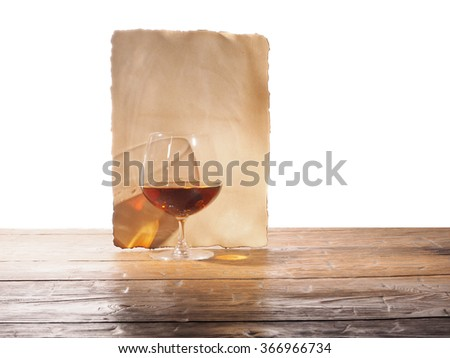 A glass of brandy, old paper isolated on a white background
