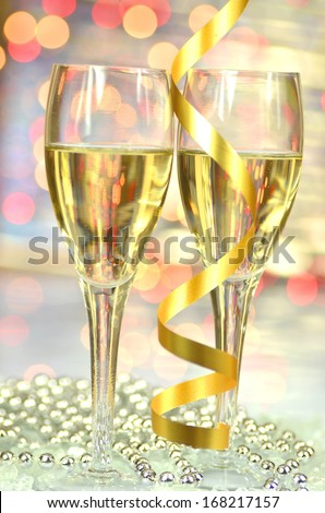 a glass of champagne against bokeh background