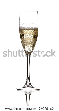 a glass of champagne filled with lots of bubbles