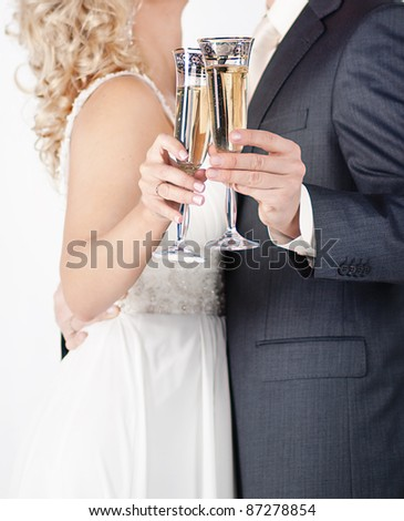 A glass of champagne in the hands of men and women - stock photo