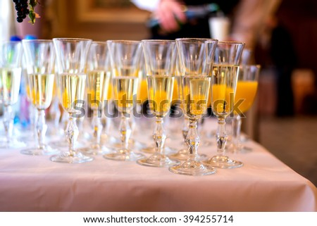 a glass of champagne juice wedding