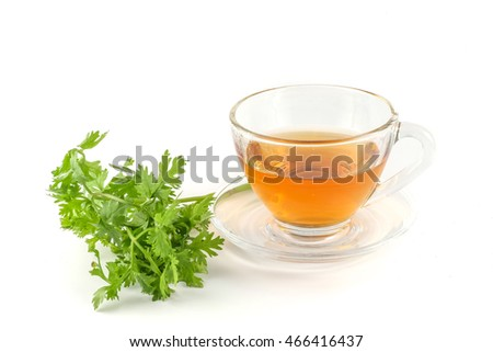 A glass of coriander tea on white background.