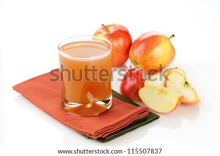 A glass of fresh apple juice on a white background