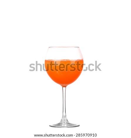 A glass of fresh grapefruit juice and grapefruit slice isolated on white background - stock photo