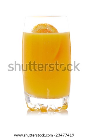 A glass of fresh orange juice reflected on white background. Shallow depth of field