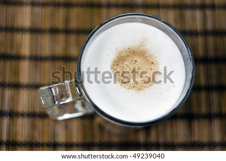 A glass of hot colorfull cofee with milk