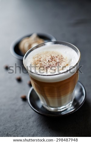 A glass of latte coffee