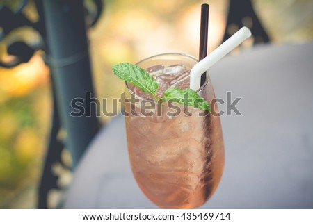 A glass of  lemonade iced. The Juice soda in afternoon. Tasty cool beverage with lemonade.(selective focus) - stock photo