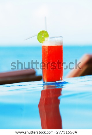 A glass of Mai Thai Cocktail at the pool in a family hotel in Ko Samui, Thailand - stock photo